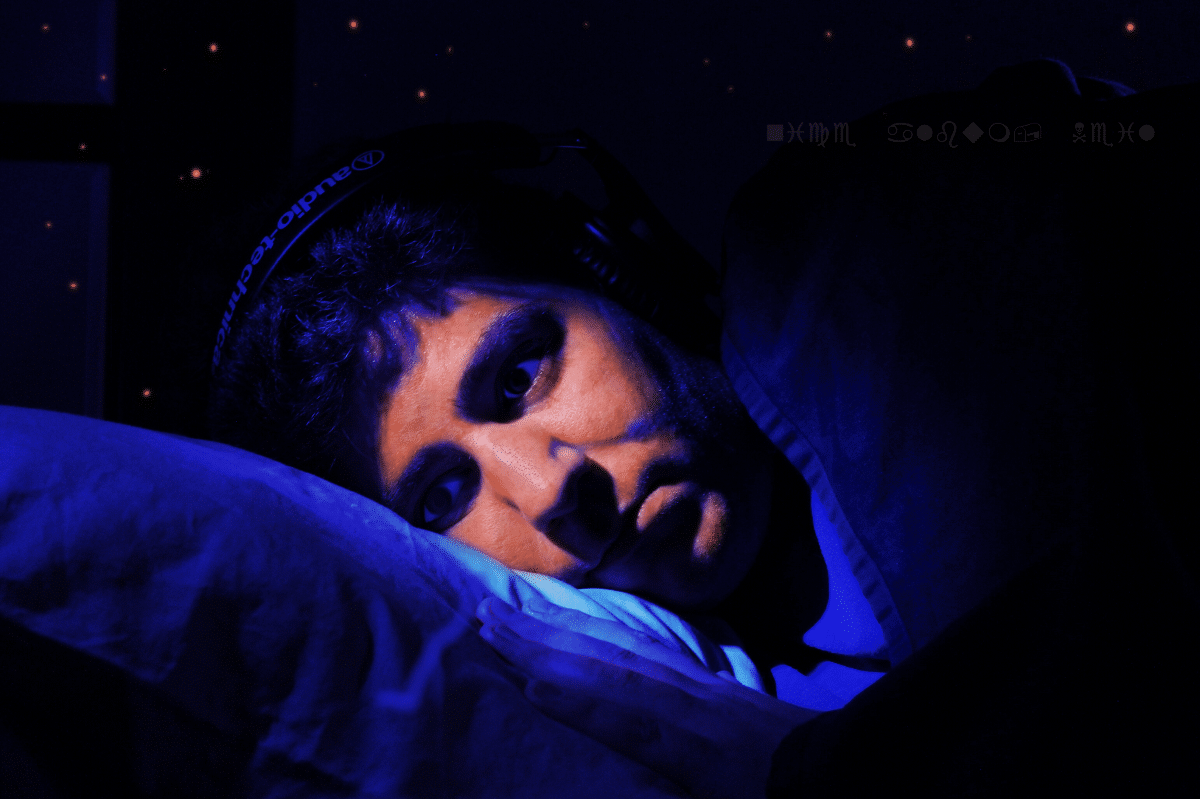 An image of me lying in bed with headphones on. It's a parody of the cover art for Mouth Dreams.