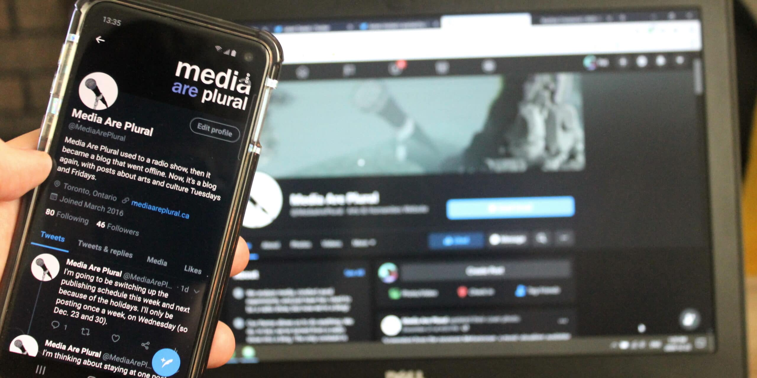 a phone displays this site's Twitter profile and a computer displays our Facebook page