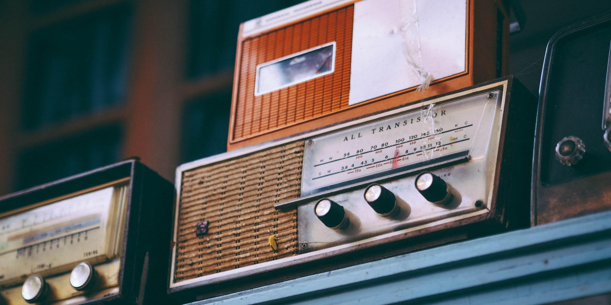 old radios sit on a shelf