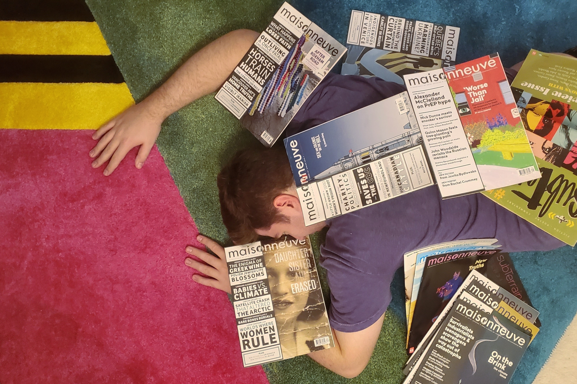 I lie on the floor covered in magazines
